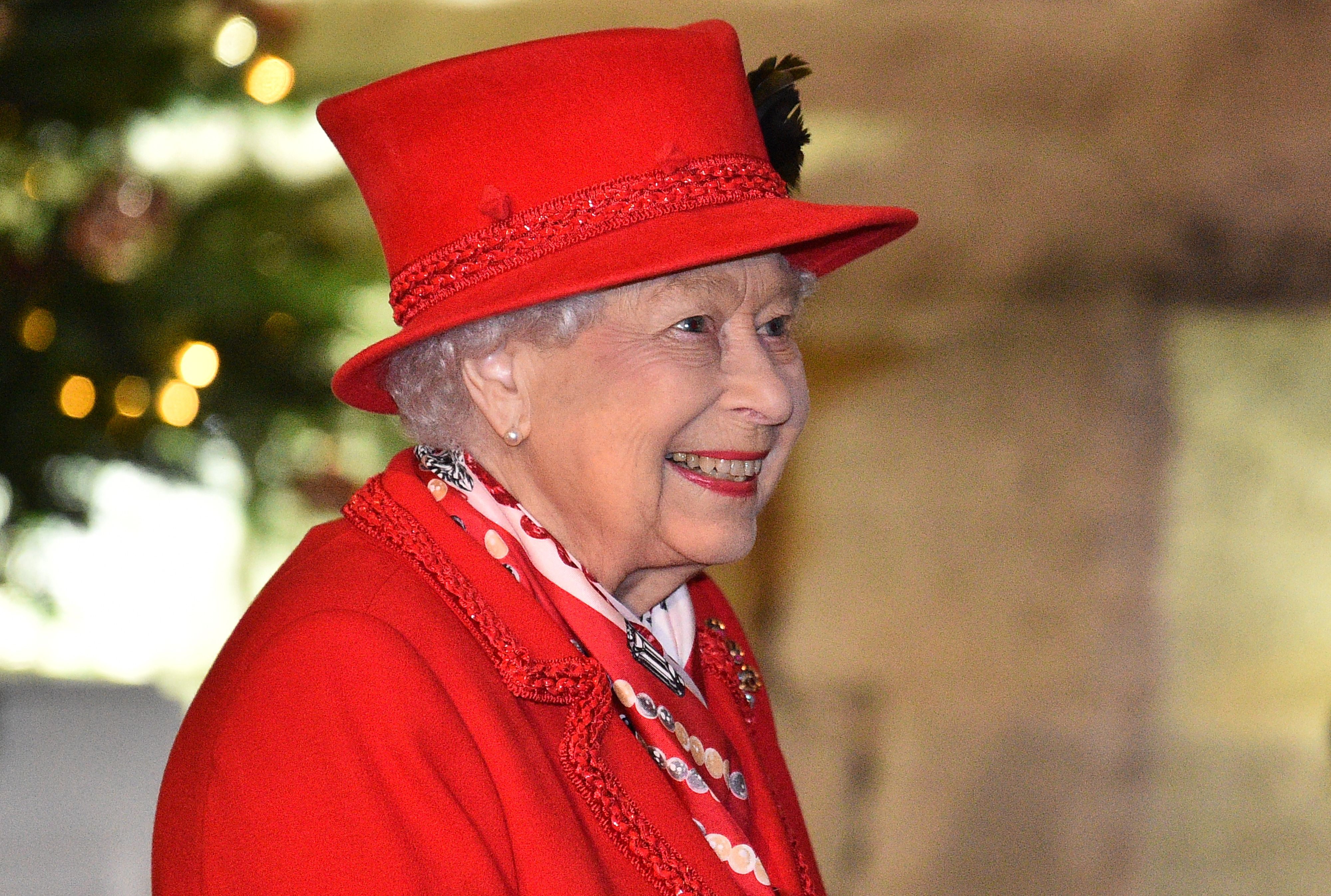 Queen Elizabeth II thanks local volunteers and key workers for the work they are doing during the coronavirus pandemic and over Christmas in the quadrangle of Windsor Castle on December 8, 2020 | Getty Images