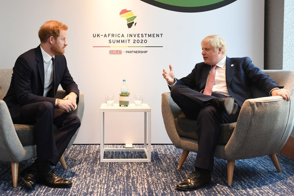 Prince Harry, Duke of Sussex, speaks with British Prime Minister Boris Johnson as they attend the UK-Africa Investment Summit at the Intercontinental Hotel in London, England | Photo: Getty Images
