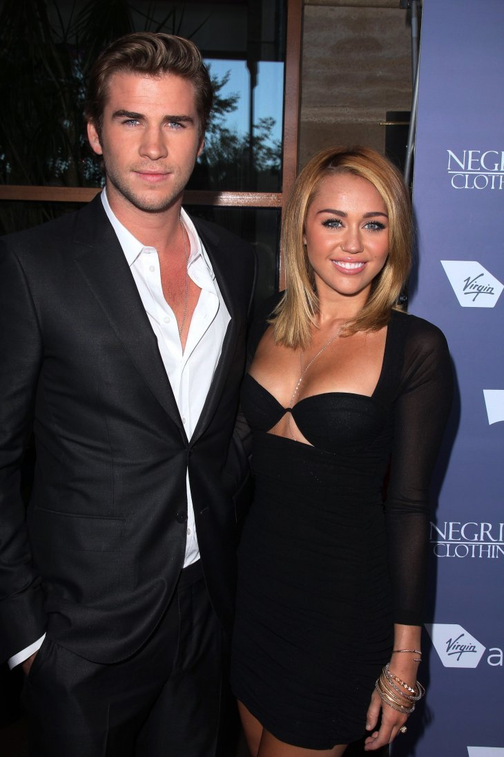 Liam Hemsworth and Miley Cyrus at the Australians in Film 8th Annual Breakthrough Awards,  June, 2012. | Photo: Getty Images