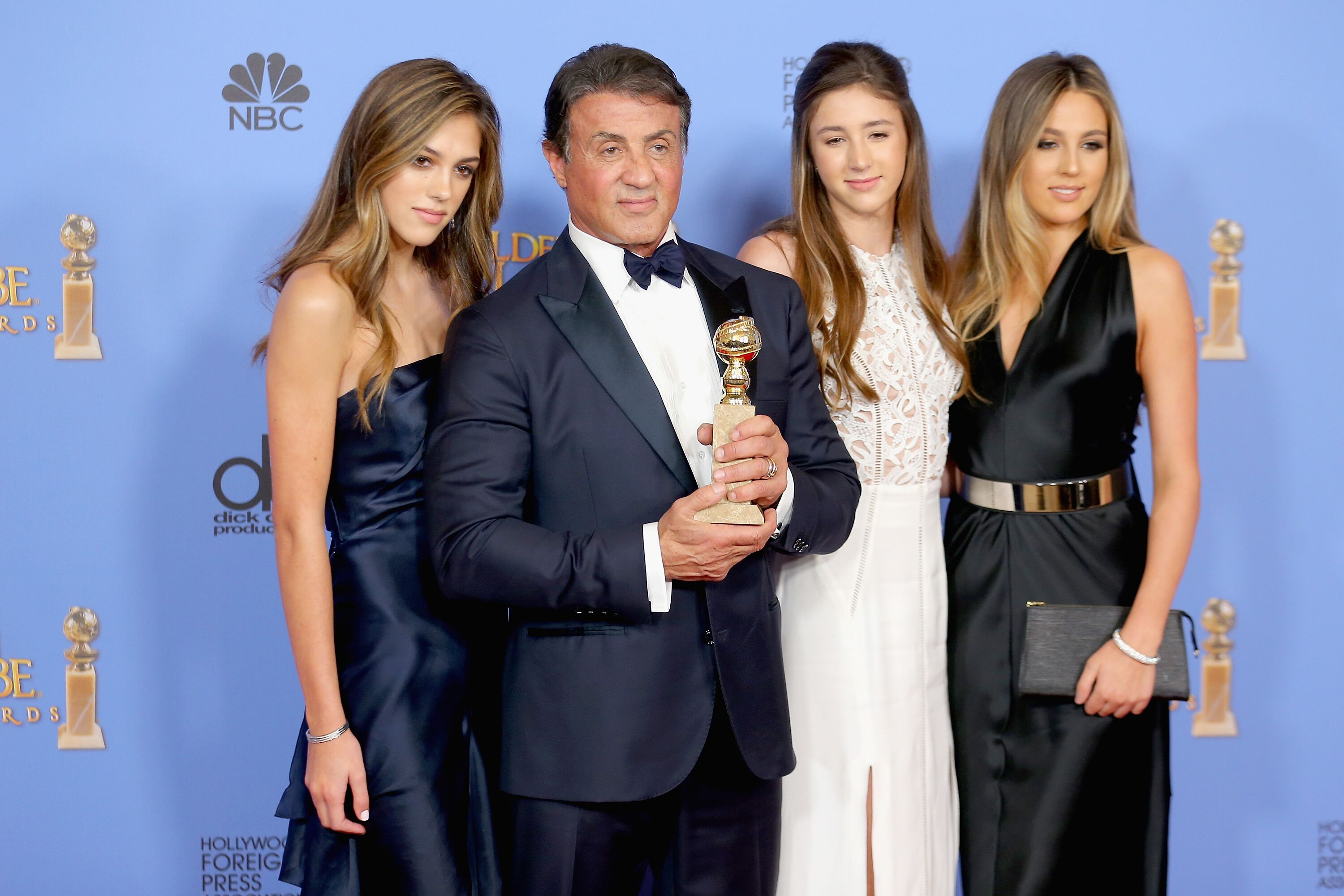 Image Source: Getty Images/Global Images Ukraine | Sylvester Stallone with his daughters Sistine, Sophia and Scarlet at the 73rd Annual Golden Globes