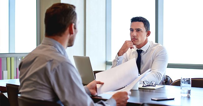 Two men discussing in an office. | Photo: Shutterstock