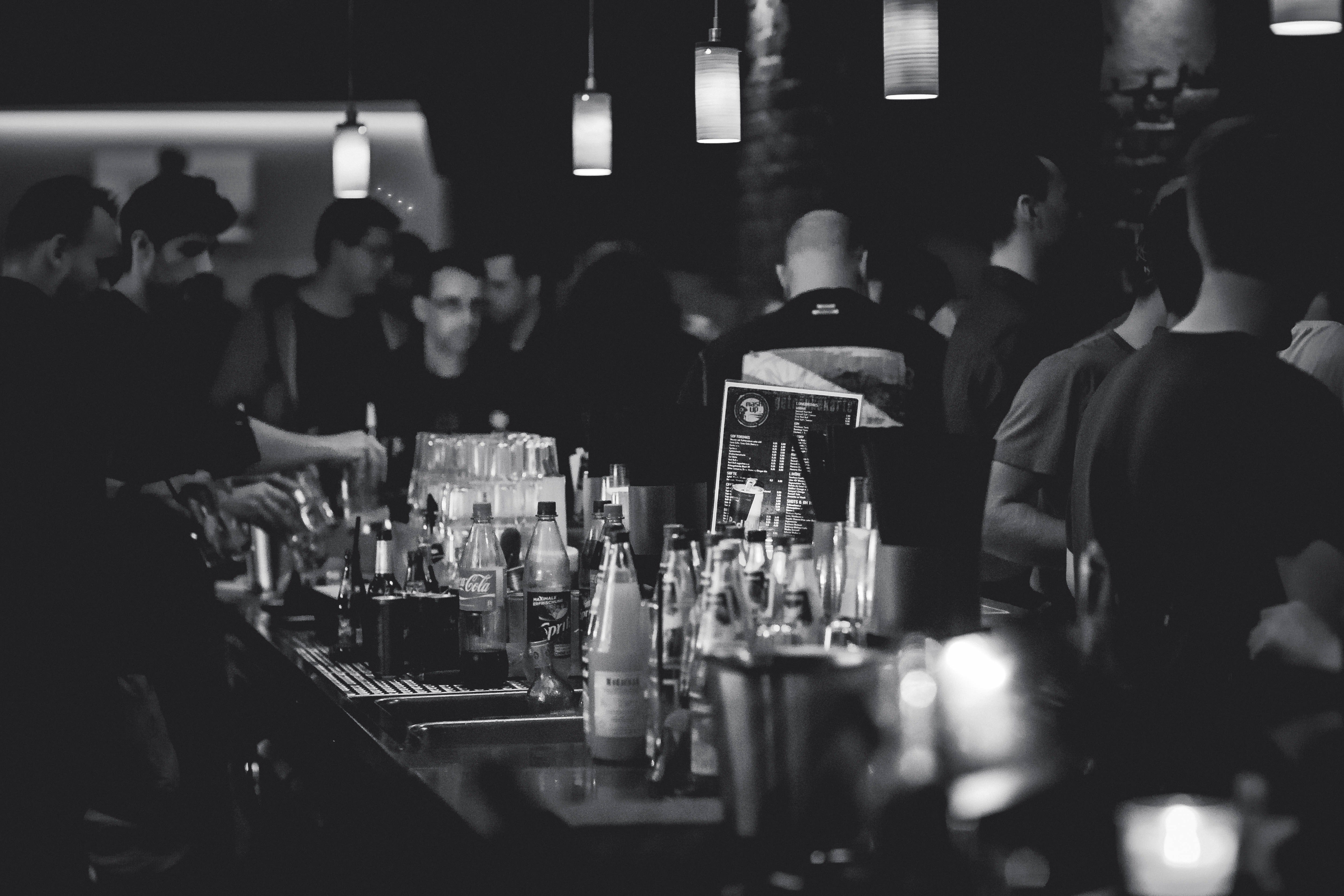 Black and white photo of a busy bar.   Pexels/ Pixabay