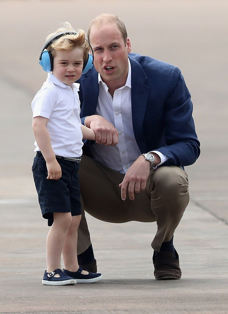 Prince William, Duke of Cambridge and Prince George during a visit to the Royal International Air Tattoo at RAF Fairford | Photo: Getty Images