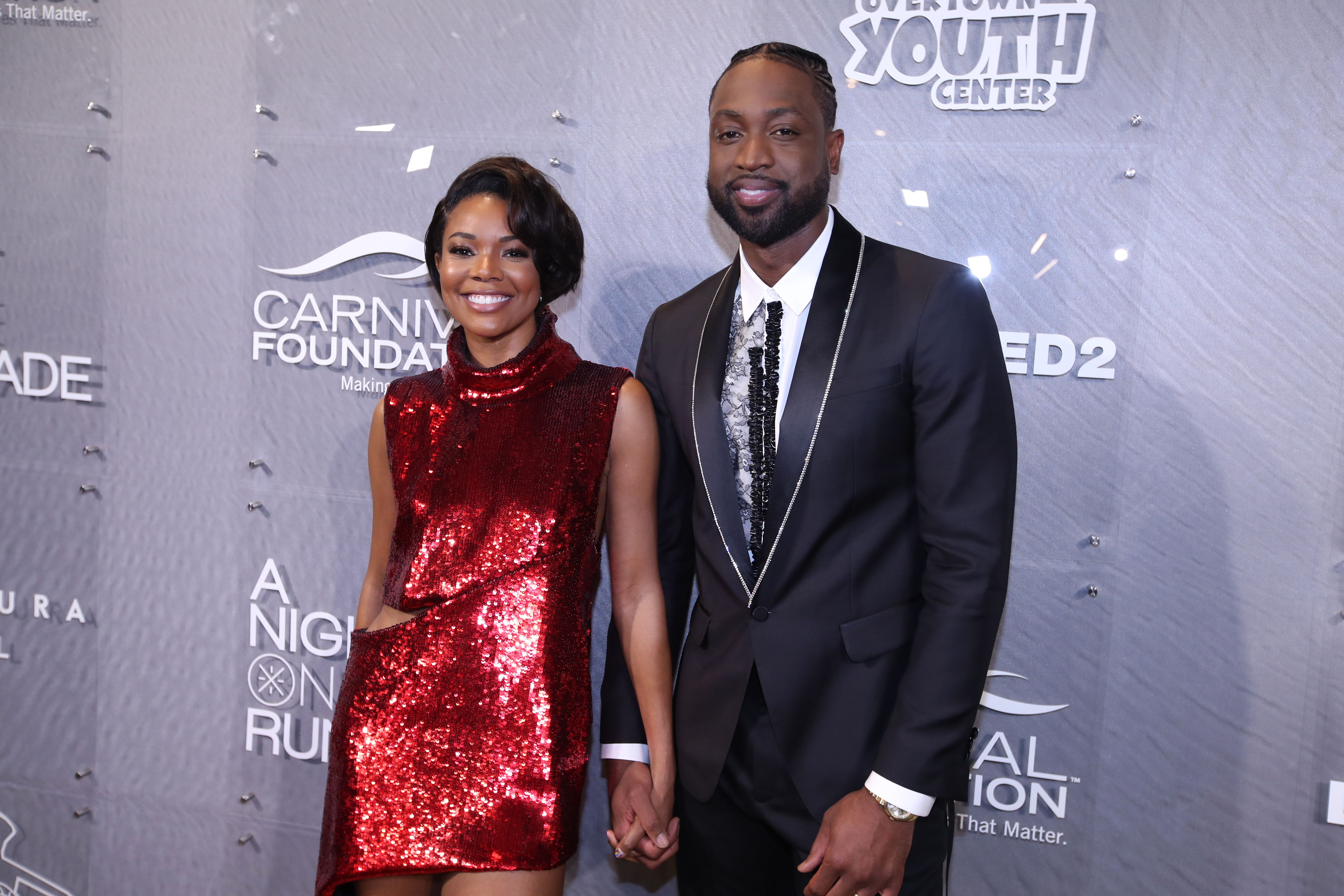 """Gabrielle Union and Dwyane Wade during """"A Night on the RunWade"""" at Level Three on March 16, 2019 in Miami, Florida. 