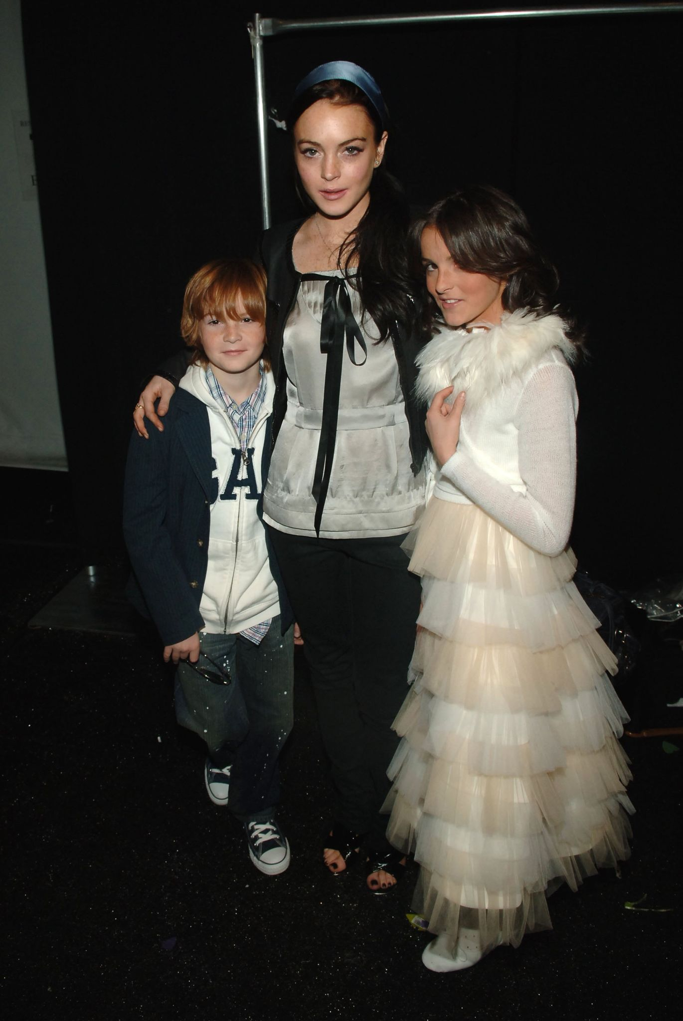 Lindsay Lohan,  sister Aliana, and brother Dakota at the Child Magazine Fall 2006 fashion in 2006 in New York City | Source: Getty Images