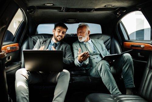 Men in a limousine talking. | Source: Shutterstock.