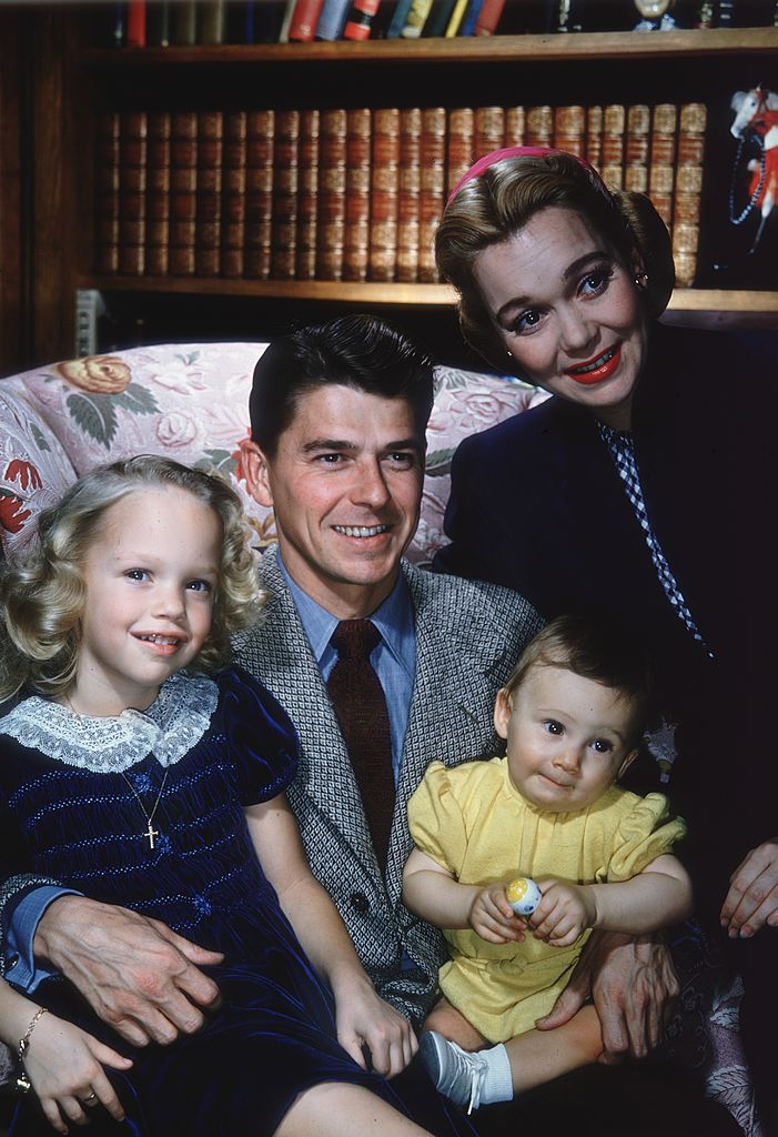Portrait of married couple Ronald Reagan and Jane Wyman with their two children, Maureen (1941 - 2001) and Michael. | Source: Getty Images