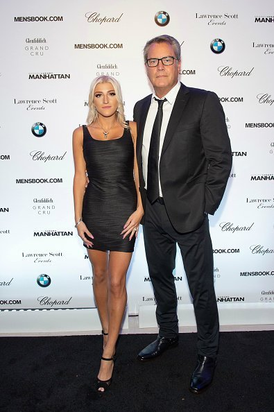 Alba Jancou and Peter Cook attend the Manhattan Magazine and Mensbook.com Celebration with Cover Star Aaron Paul at BMW of Manhattan in New York City. | Photo: Getty Images