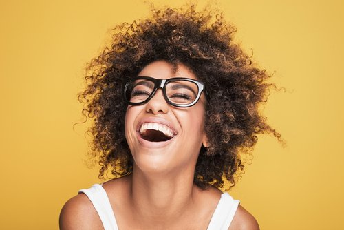 A woman laughing. | Source: Shutterstock.