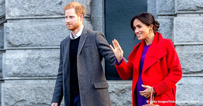 Meghan Markle flaunts baby bump in purple dress & red coat while in Birkenhead with Prince Harry