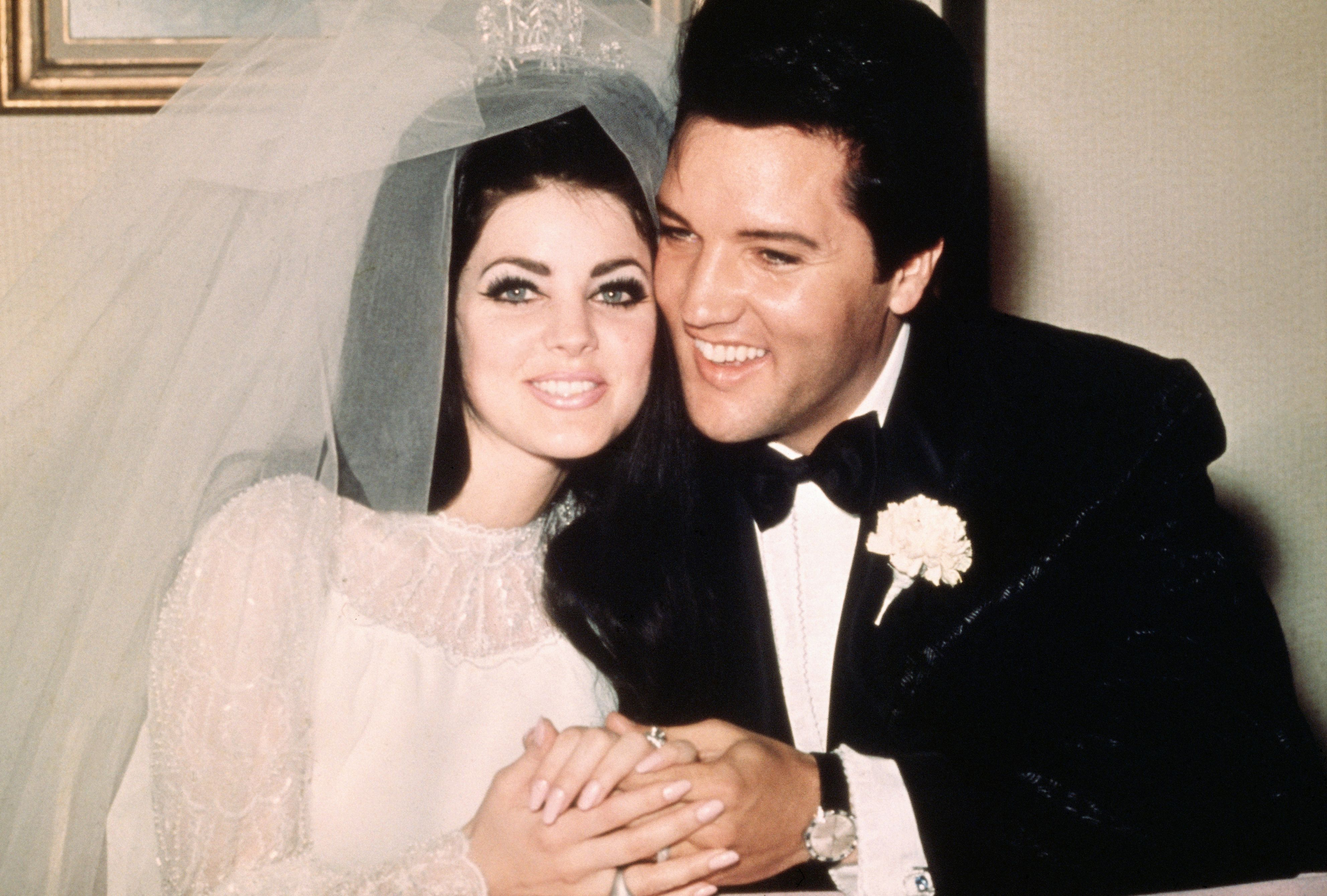 Elvis Presley with Priscilla Presley following their wedding on May 1, 1967 | Photo: Getty Images