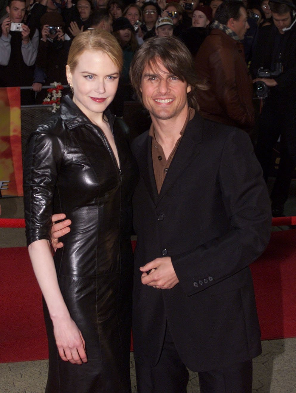 """Tom Cruise and Nicole Kidman pose for photographers at the Sydney premiere of """"Mission Impossible 2"""" May 30, 2000 at Fox Studios in Australia. 