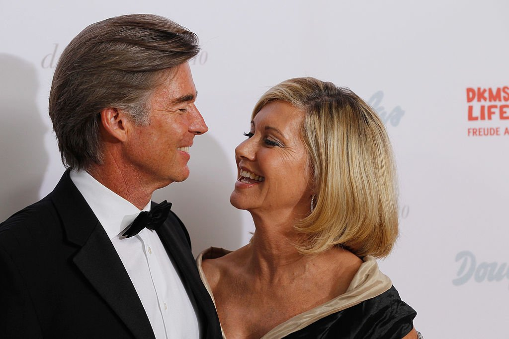 Olivia Newton-John with her husband, John Easterling, pictured at the Dreamball 2010 charity gala at the Grand Hyatt hotel, Berlin, Germany. | Photo: Getty Images
