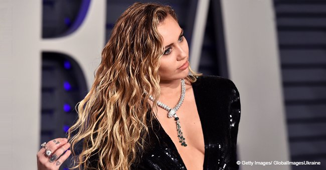 Miley Cyrus Goes Braless in a Plunging Dress with so Many Diamonds: 'It's Cold in Here'
