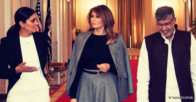 Melania Proves She's the 'Classiest First Lady' by Wearing a Gray Jacket Slung over Her Shoulders