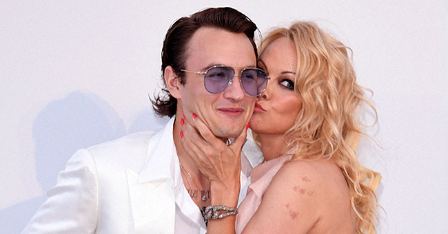 Pamela Anderson Showers Her Son Brandon Lee with Kisses during a Rare Mother-Son Appearance in Cannes
