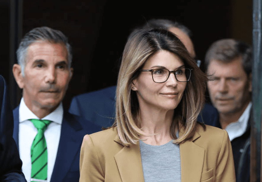 For their role in the national college admission scandal, Lori Loughlin and her husband, Mossimo Giannulli are followed by cameras as they leave the John Joseph Moakley United States Courthouse, on April 3, 2019, Boston | Source: Pat Greenhouse/The Boston Globe via Getty Images