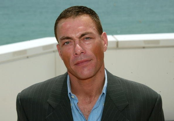 Actor Jean-Claude Van Damme poses during a photocall on the roof at the Noga Hilton during 56th International Cannes Film Festival 2003 on May 18, 2003, in Cannes, France. | Source: Getty Images.
