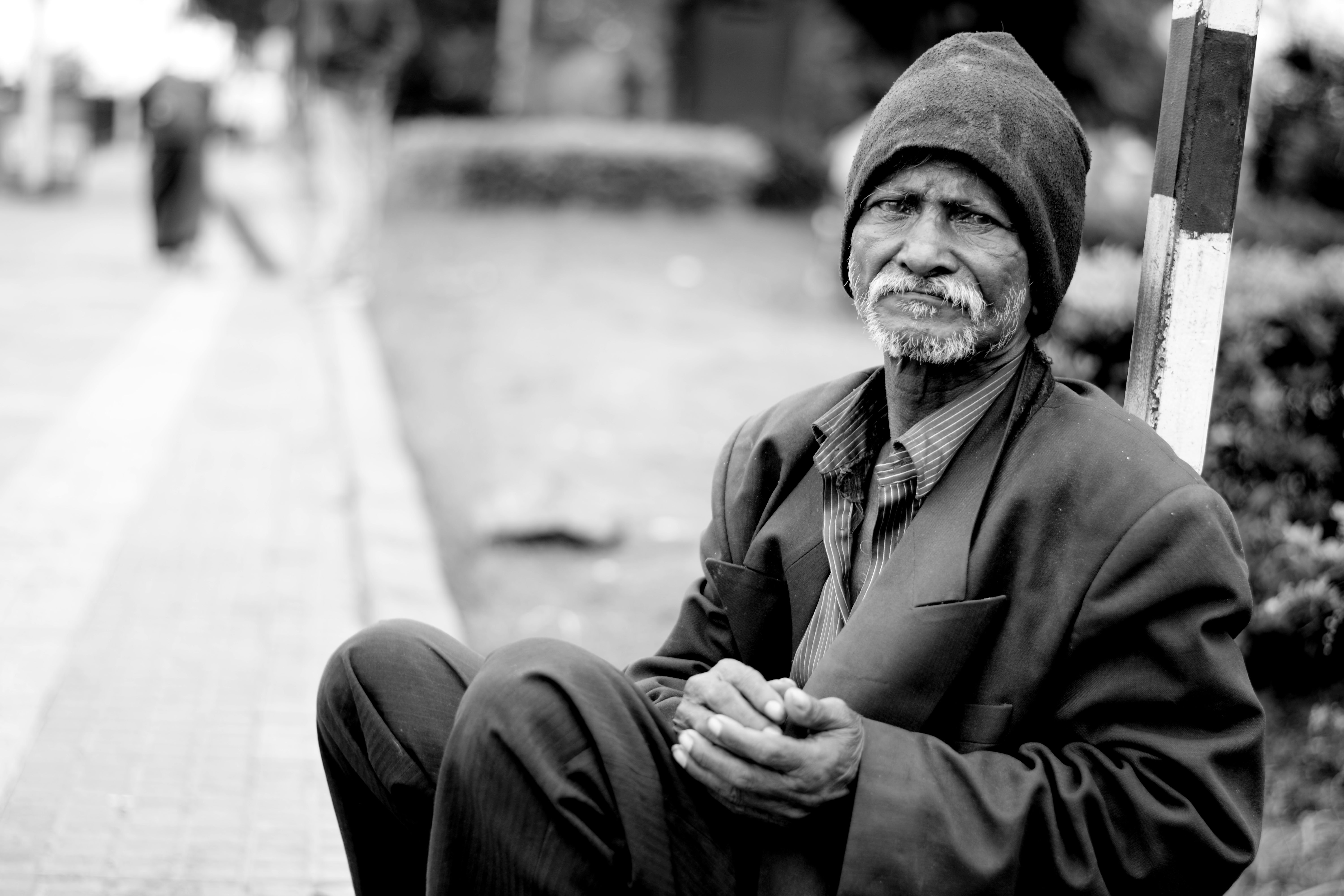 Black and white photo of a homeless man.   Pexels/ Pixabay
