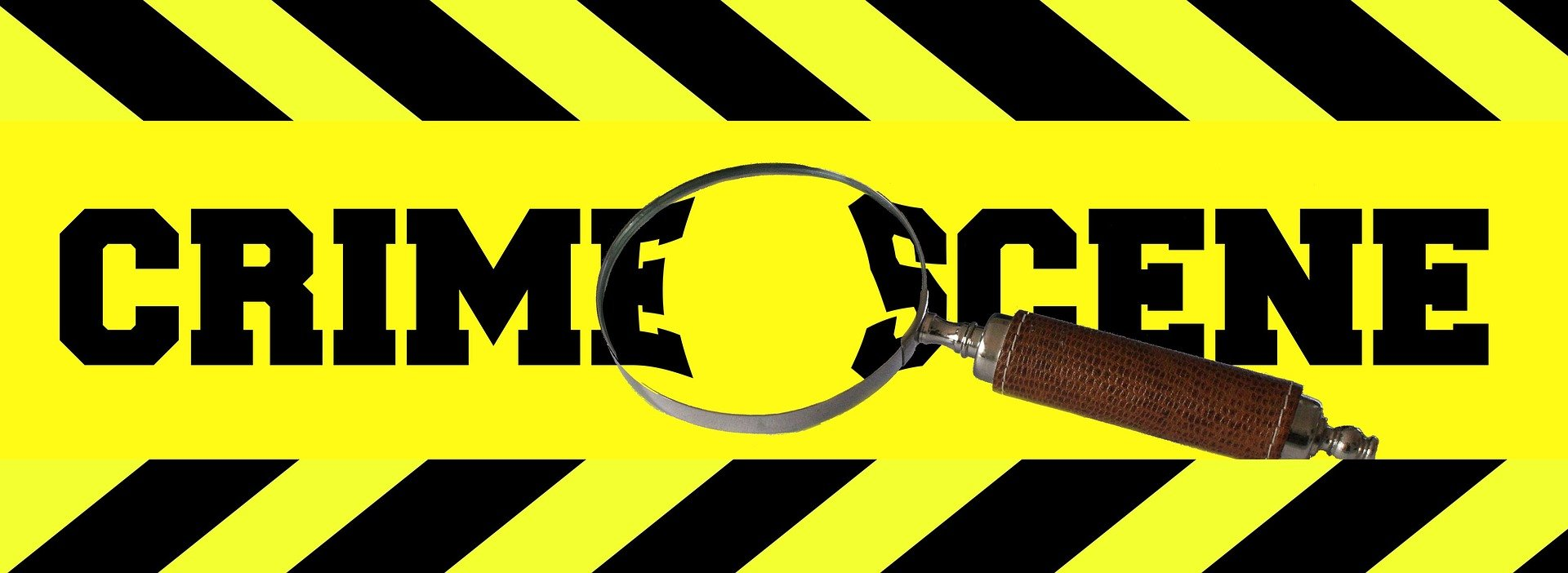 Pictured - A crime scene tape and a magnifying glass | Source: Pixabay
