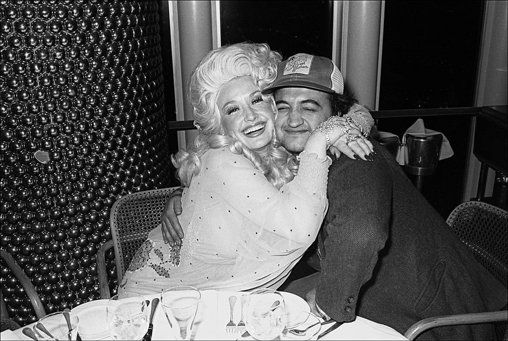 Dolly Parton and Jim Belushi. Image Credit: Getty Images