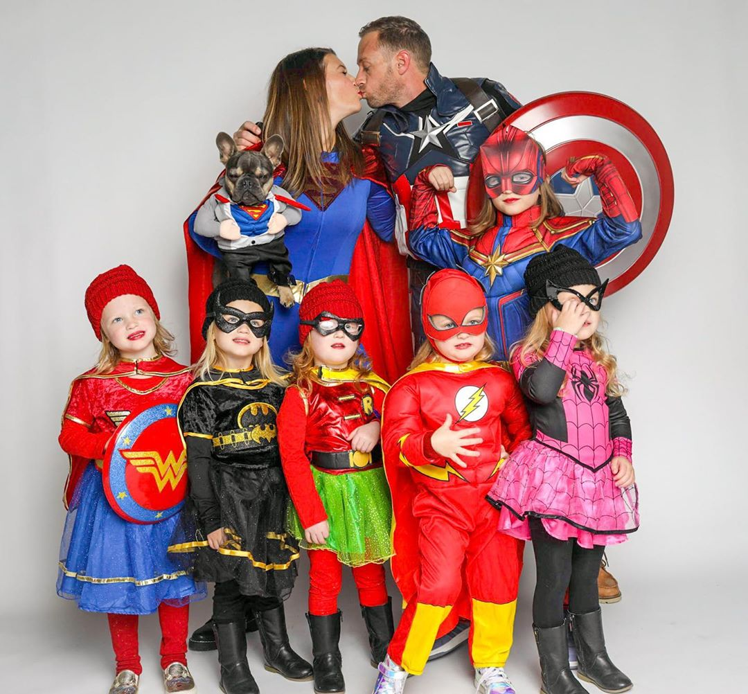 """The """"OutDaughted"""" Busby family pictured in superhero costumes. 