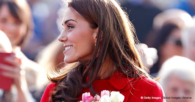 Kate Middleton Stuns the Crowd with Her Classy Red Coat during a Surprise Outing with William