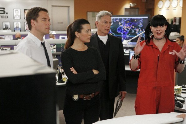 (lL-R) Michael Weatherly, Cote de Pablo, Mark Harmon and Pauley Perrette in an episode of NCIS | Photo: Getty Images