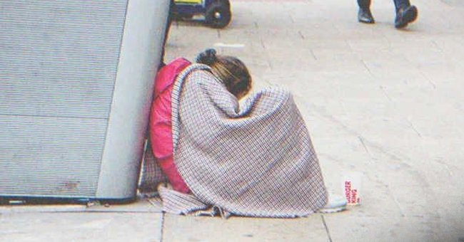 Jane watched as Junior walked towards a poor homeless woman and a teenage girl next to her | Source: Shutterstock
