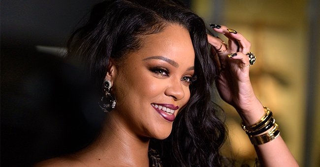 Rihanna Puts Her Legs on Display in a Crocheted Mini Dress & Matching Shoes