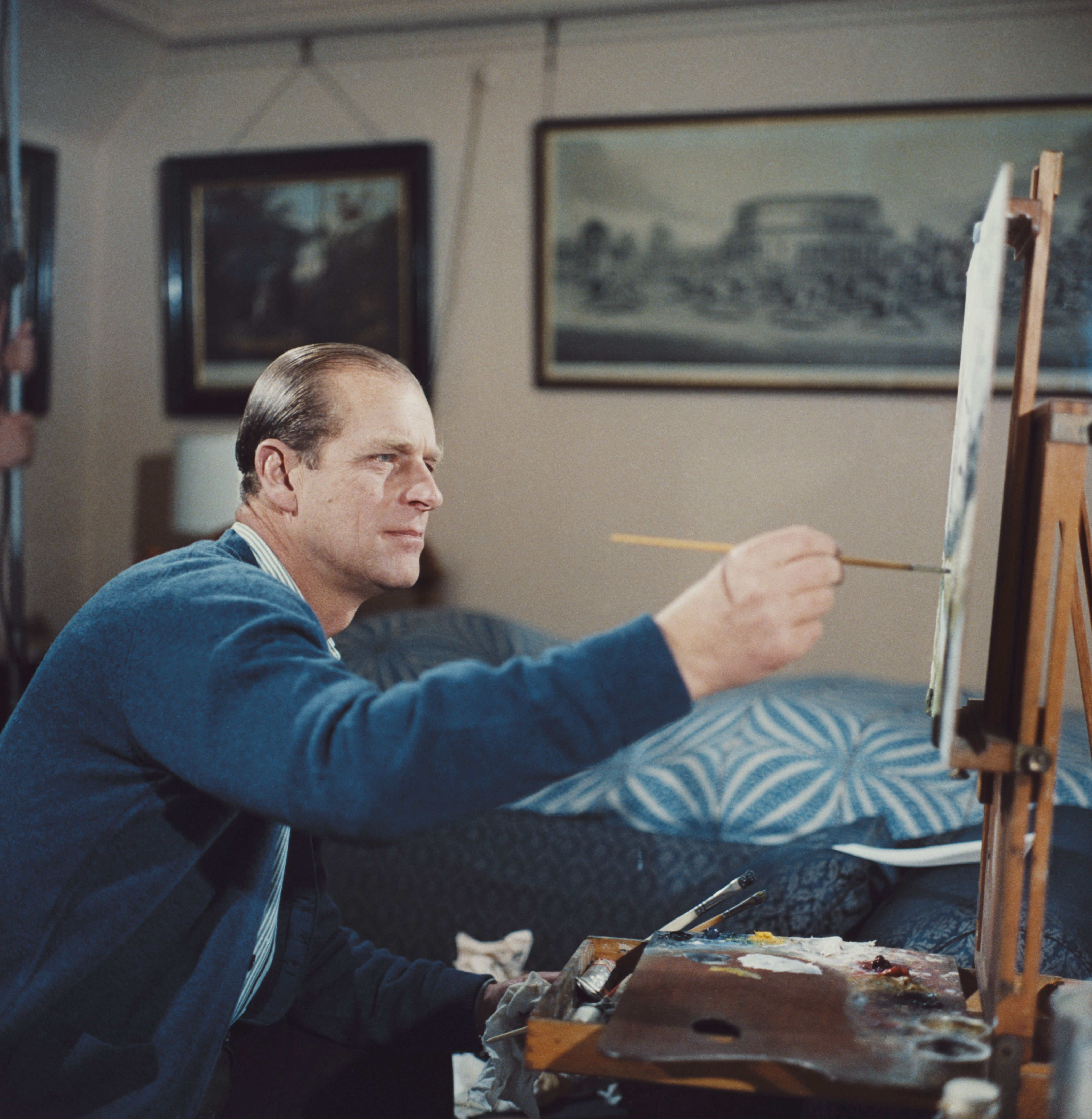 Prince Philip painting with oils during filming of the television documentary 'Royal Family' in London in 1969 | Source: Getty Images