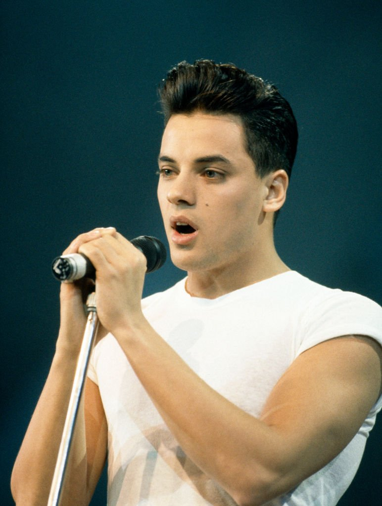 Nick Kamen pictured singing on stage in 1987, London, England.