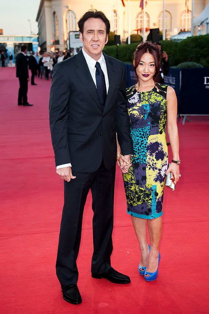 Nicolas Cage and Alice Kim arrive at the premiere of the movie 'Joe' during the 39th Deauville American film festival | Photo: Getty Images