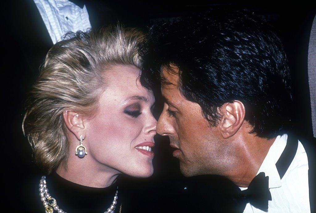 American actor Sylvester Stallone (R) and Brigitte Nielsen attend a ceremony where he was presented with the 'Man of the Year' award by the Hasty Pudding Theatricals group at Harvard University | Photo: Getty Images