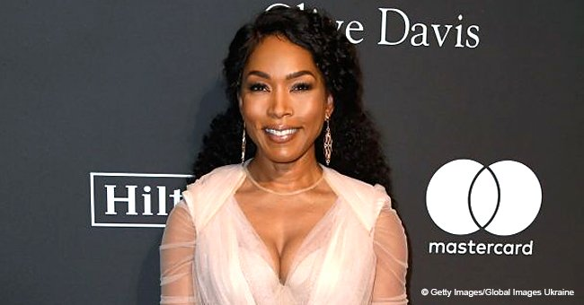Angela Bassett, 60, leaves little to the imagination in cleavage-baring blouse at pre-Grammys party