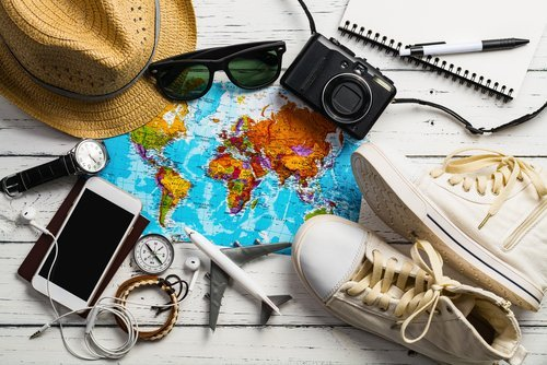 Traveler's accessories, Essential vacation items, Travel concept background. | Source: Shutterstock