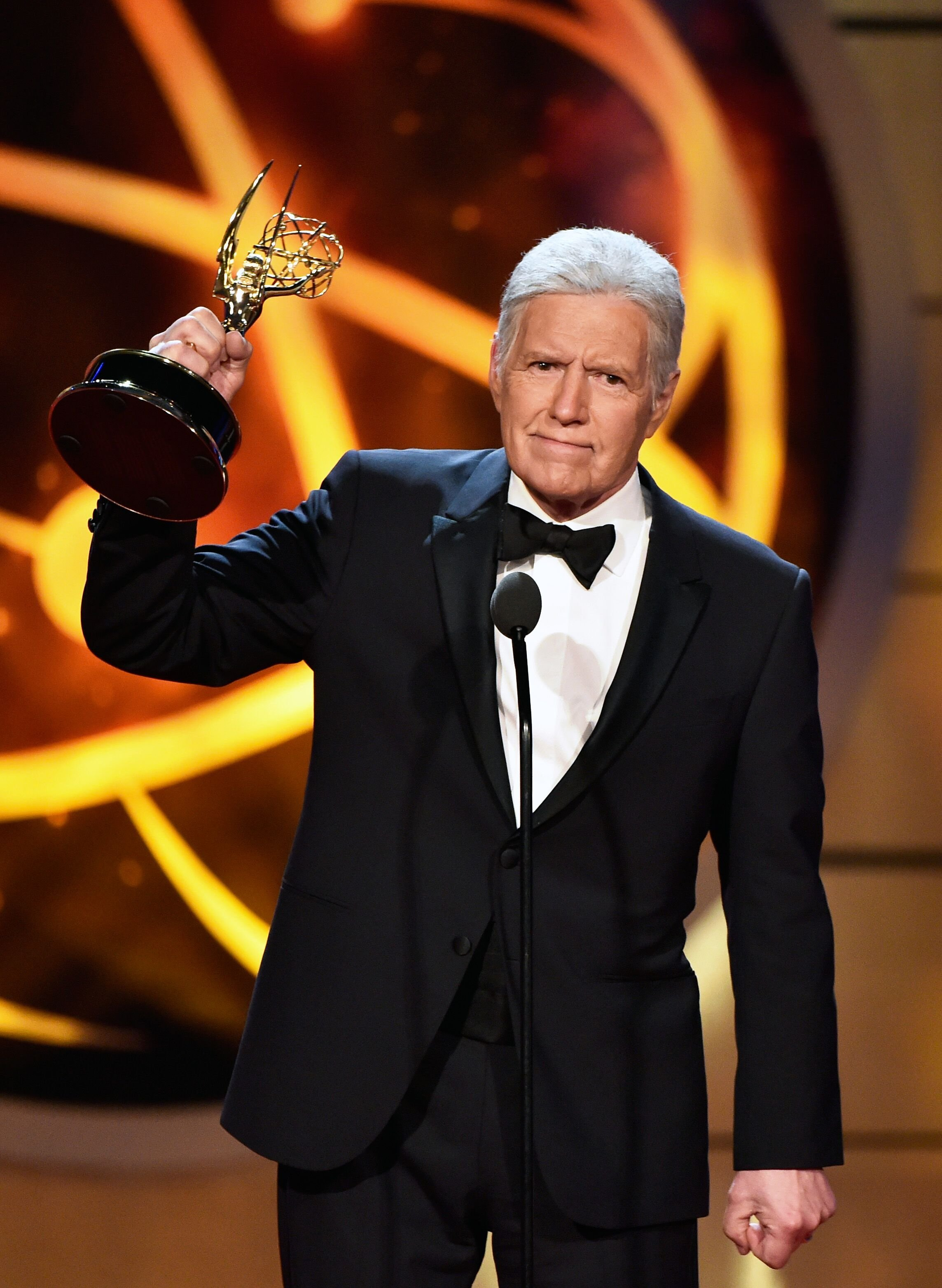 Alex Trebek accepts a Daytime Emmy Award for Outstanding Game Show Host. | Source: Getty Images