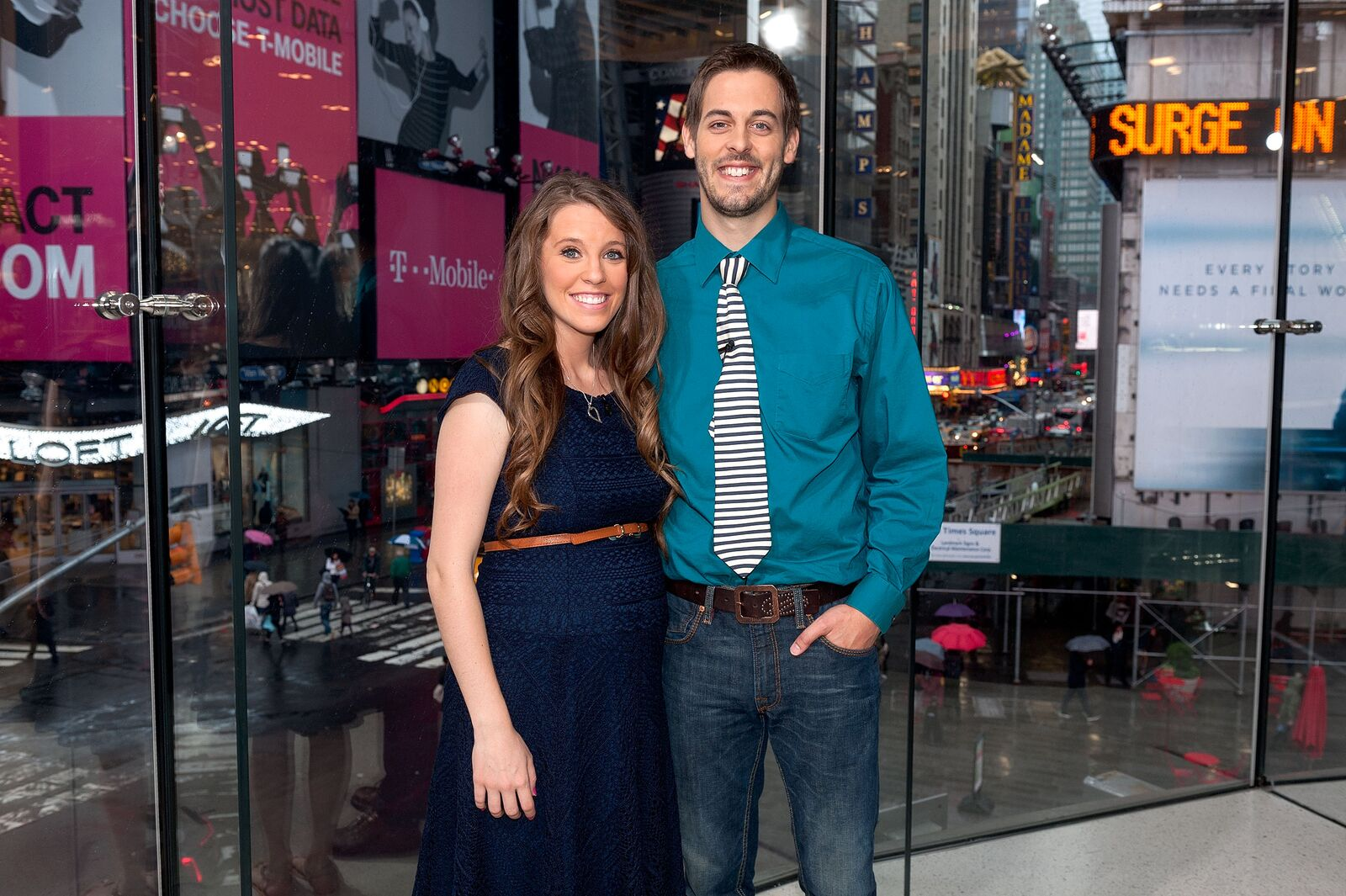 """Jill Duggar Dillard (L) and husband Derick Dillard visit """"Extra"""" at their New York studios at H&M in Times Square on October 23, 2014 in New York City 