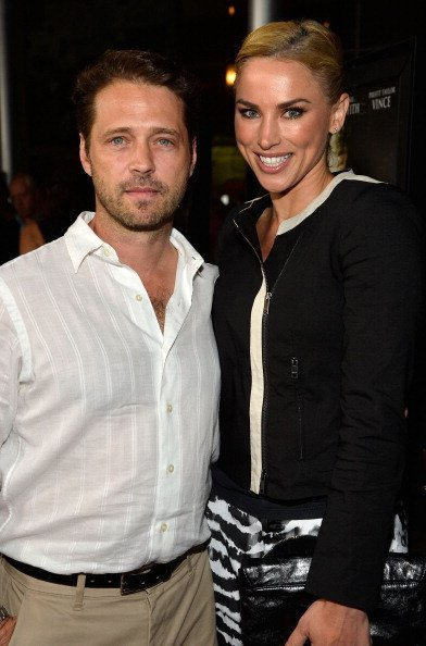 """Jason Priestley and Naomi Lowde Priestley arrive at the Premiere Of """"Dark Tourist"""" at ArcLight Hollywood on August 14, 2013, in Hollywood, California. 