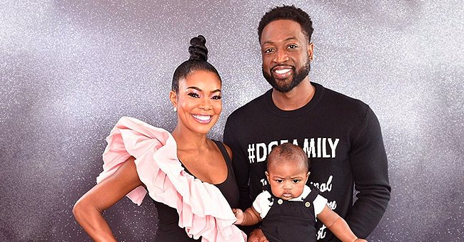 Dwyane Wade's Daughter Kaavia Stares with Interest as Dad Gets His Beard Trimmed in Photo