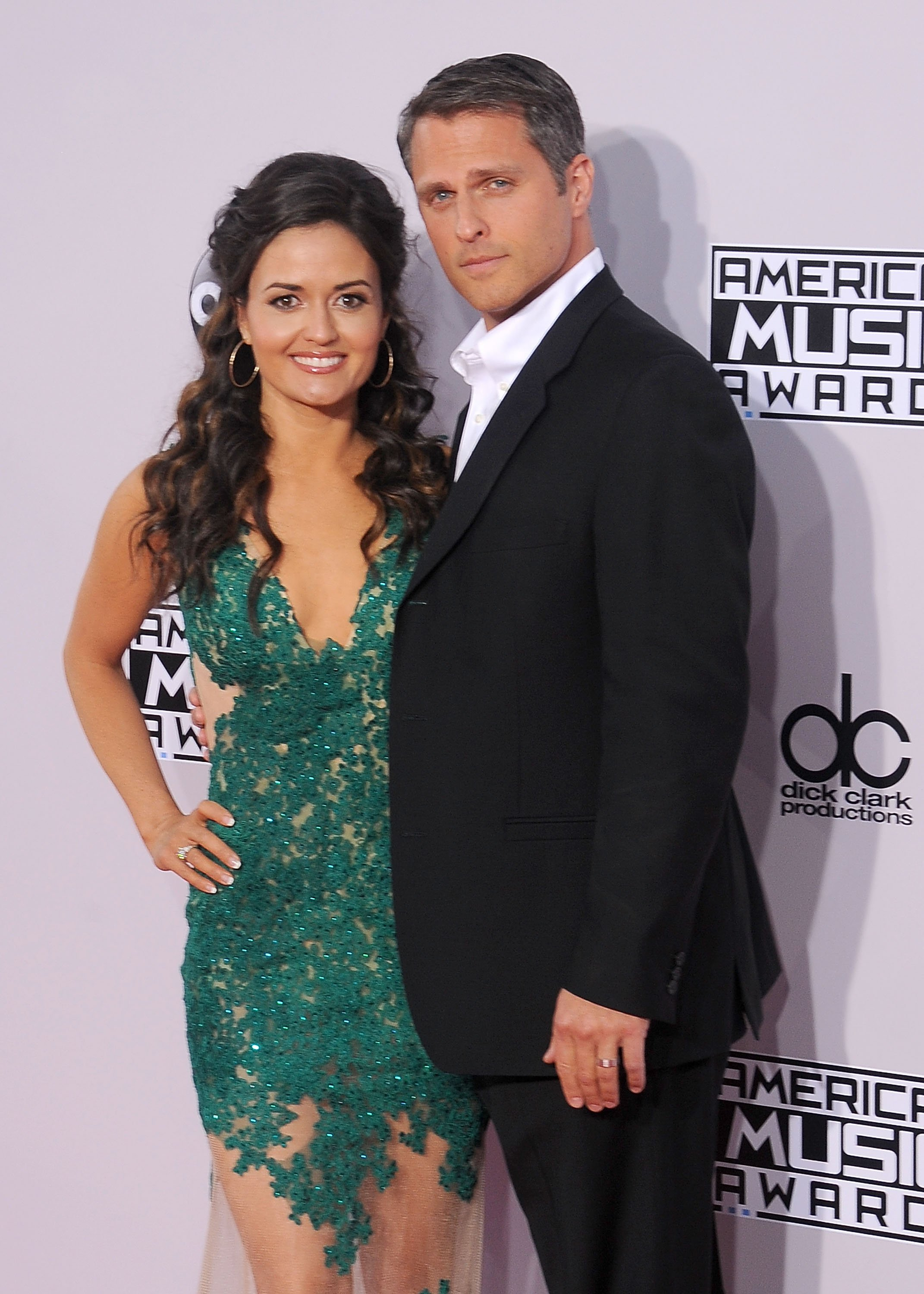 Danica McKellar and husband Scott Sveslosky arrive at the 2014 American Music Awards at Nokia Theatre L.A. Live on November 23, 2014 | Photo: GettyImages