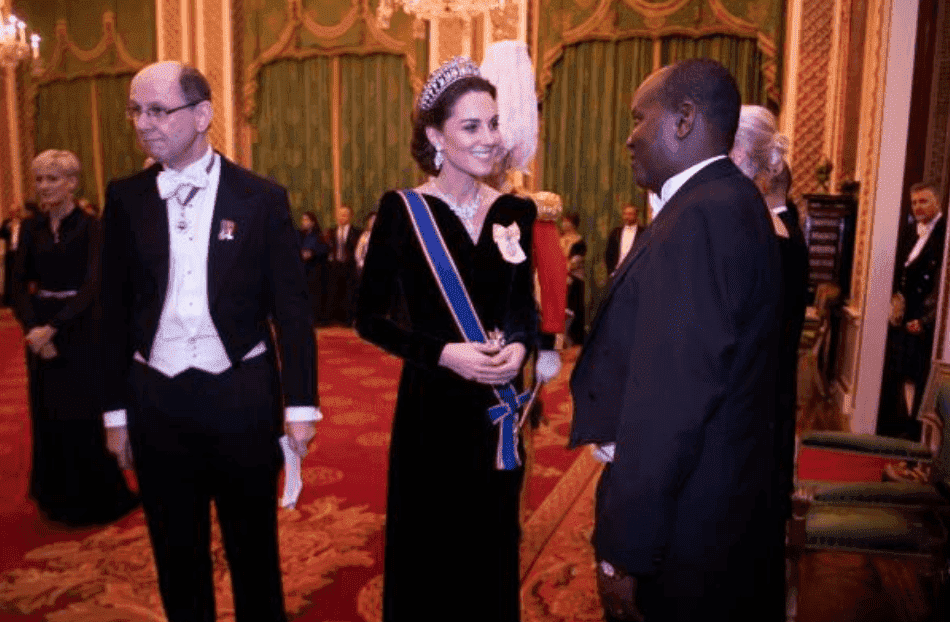Kate Middleton talks with guests at the reception for members of the Diplomatic Corps at Buckingham Palace, on December 11, 2019, in London, England | Source: Victoria Jones - WPA Pool/Getty Images
