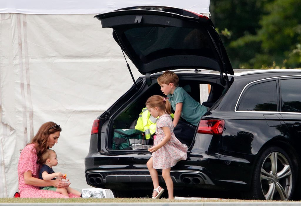 Kate Middleton and her kids, Prince Louis, Princess Charlotte, and Prince George attend the King Power Royal Charity Polo Match | Photo: Getty Images