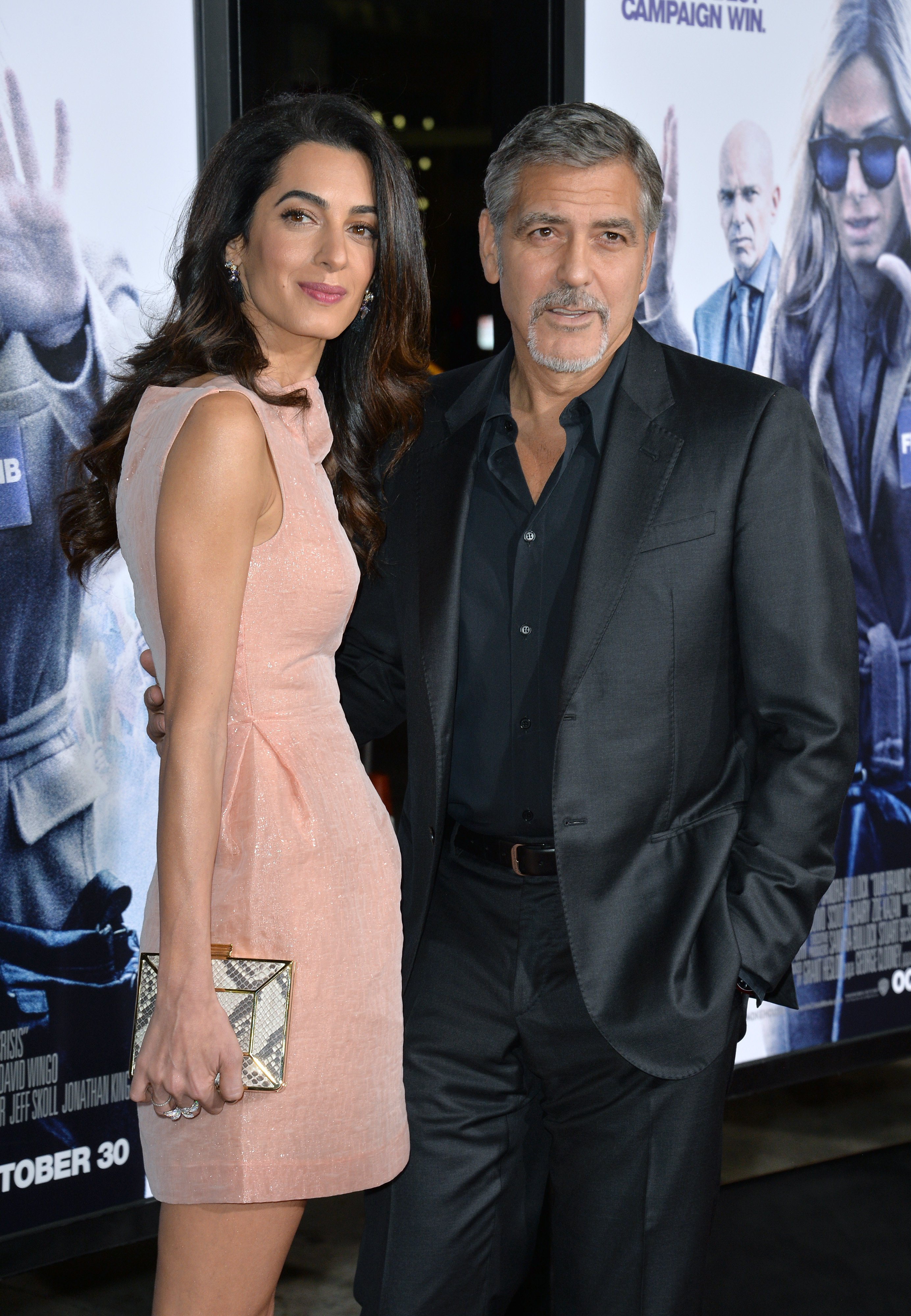 """Producer George Clooney & wife Amal Alamuddin at the premiere of his movie """"Our Brand is Crisis"""" at the TCL Chinese Theatre, Hollywood on October 26, 2015. 