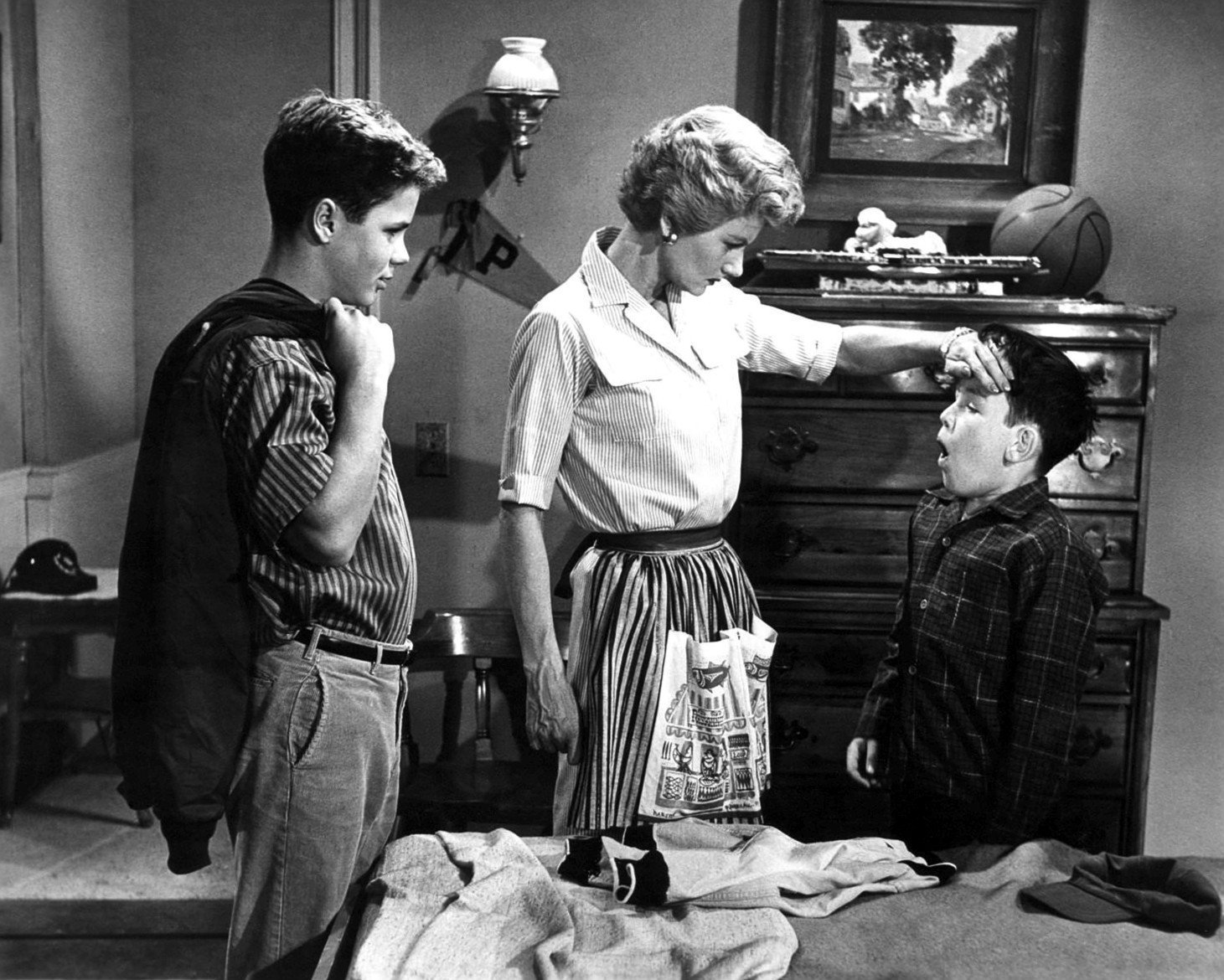 """Tony Dow, Barbara Billingsley and Jerry Mathers in a scene from """"Leave it to Beaver."""" 