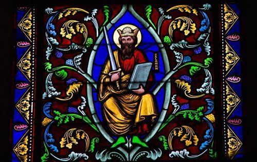 Stained Glass window depicting King Solomon in Bayeux, Calvados, France on February 12, 2013.  Photo: Shutterstock