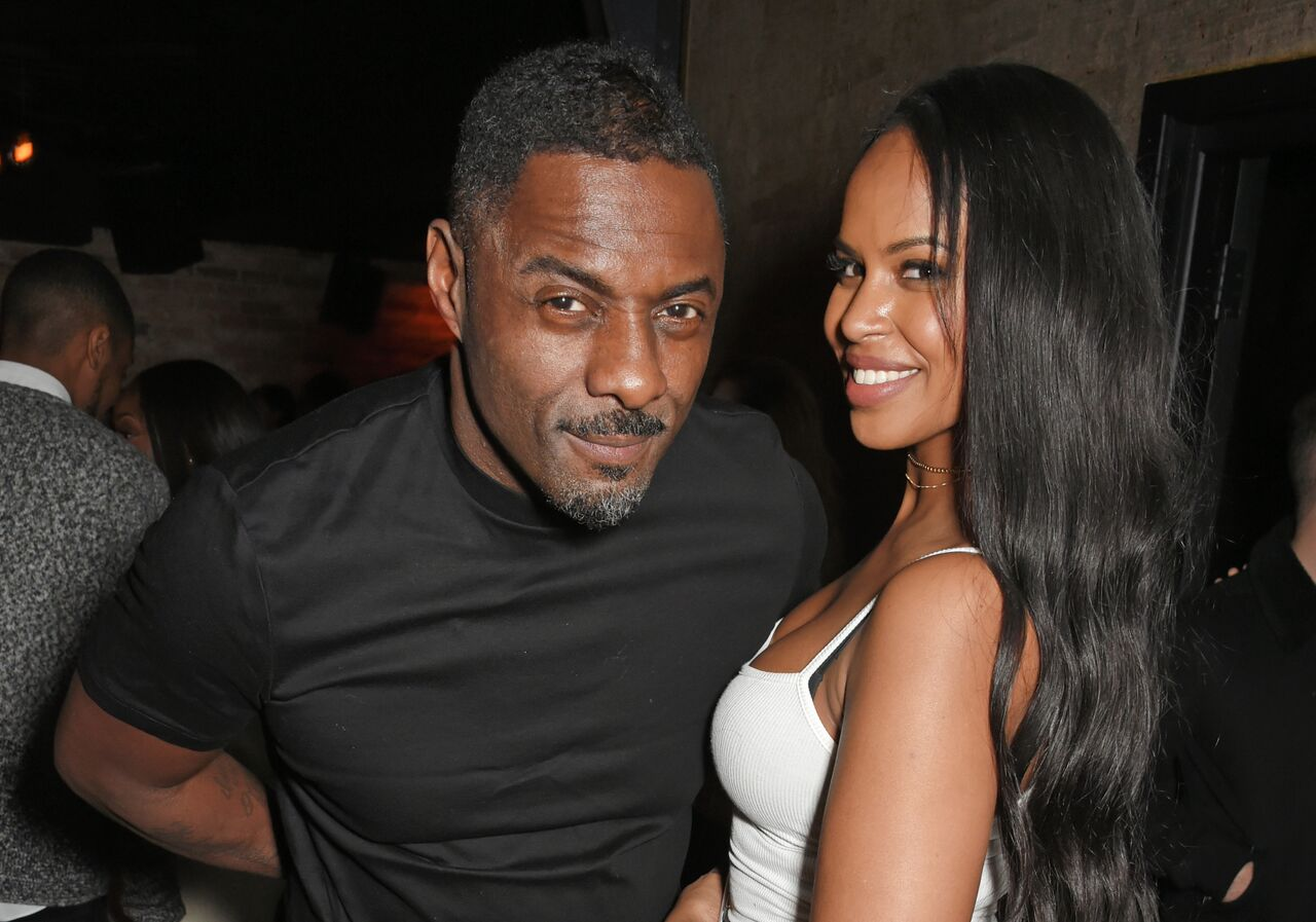 Idris Elba (L) and Sabrina Dhowre attend Idris Elba's Christmas Party at Kadie's Cocktail Bar & Club on December 9, 2017 in London, England | Photo: Getty Images