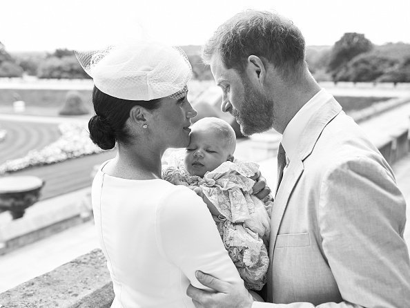 Prince Harry, Duke of Sussex and Meghan, Duchess of Sussex pose with their son, Archie Mountbatten-Windsor with the Rose Garden in the background at Windsor Castle | Photo: Getty Images