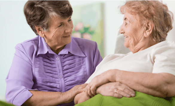 Happy elder woman spending time with her ill friend | Source: Shutterstock