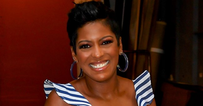 Tamron Hall's Baby Moses Shows His Cheeks & Puffy Hair While Walking a Dog in New Adorable Snap